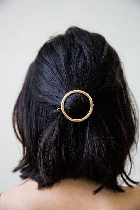 Endless way to style your hair: just try searching Etsy for an astonishing amount of amazingly creative barrettes like this round clip.
