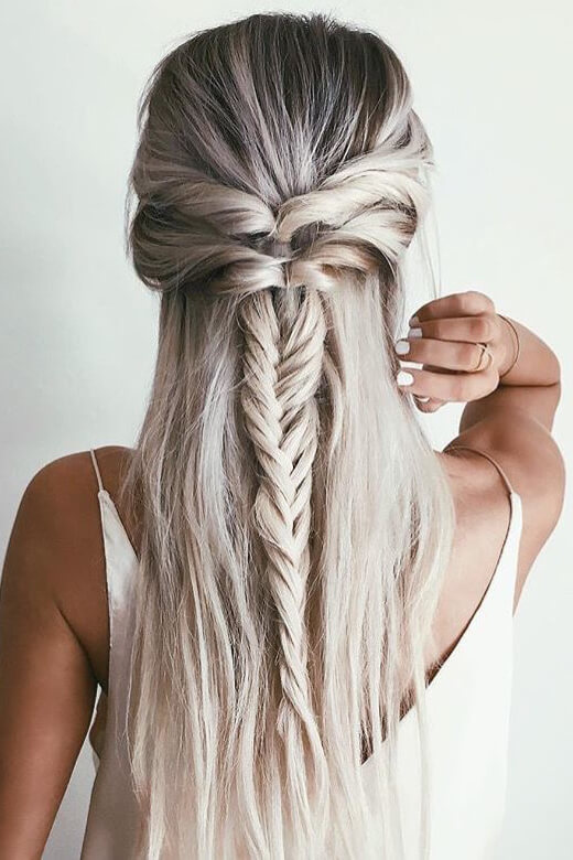 Girl with silver hair wearing half up fishtail braid.