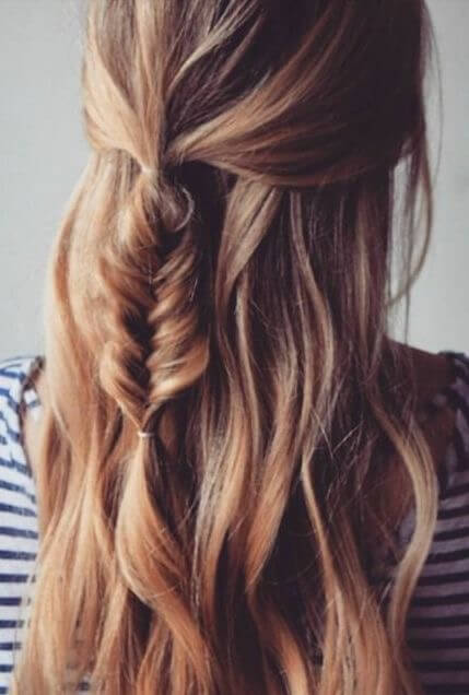 Girl with a small half up fishtail braid.