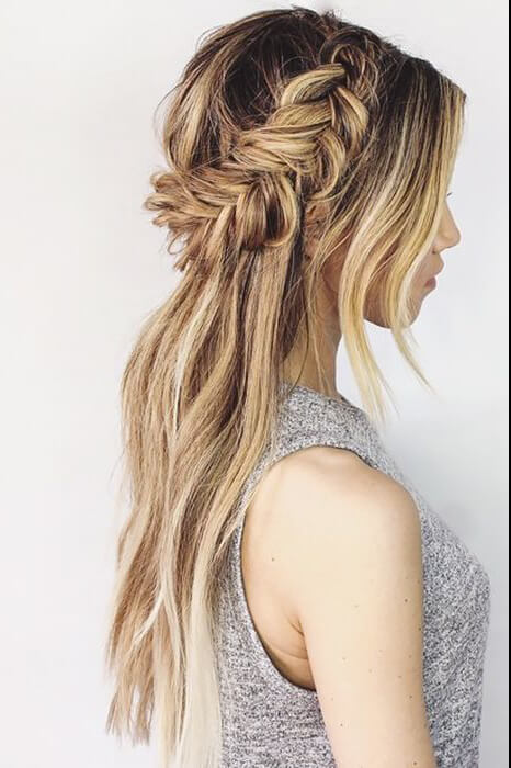 Girl with a messy half-up fishtail braid