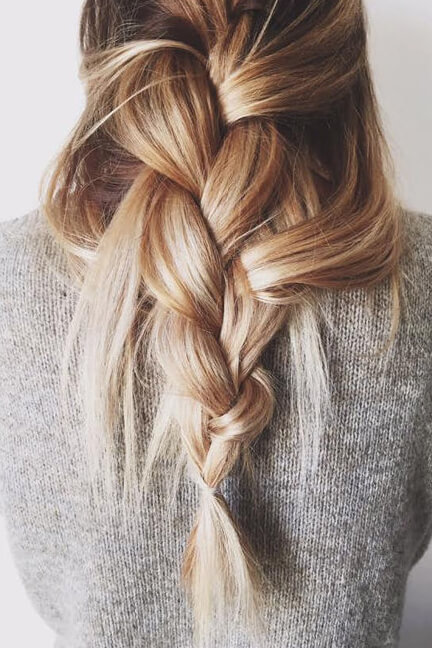 Woman with overly messy braid. This is super chic yet looks effortless.