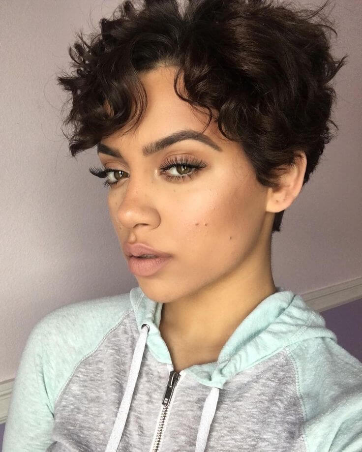 Add some bangs to your curly pixie cut