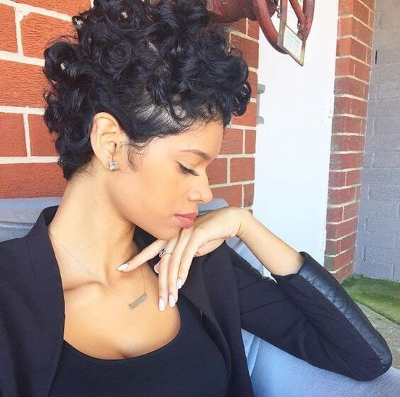 Curly pixie cuts also look great with longer layers on top
