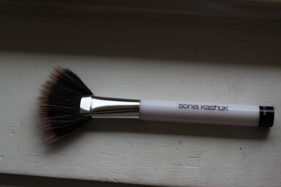 A fan brush like this one from Sonia Kashuk can double as a brush for both highlight and contour