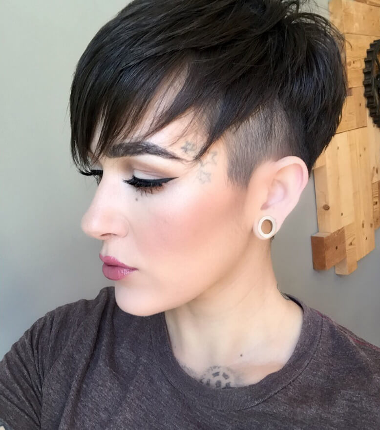 For this pixie look use a little hair gel to set the longer layers in a side sweep