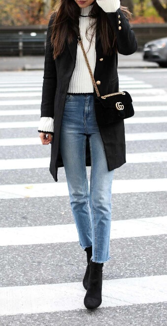 Still have that bell-sleeved top from the spring? Give it a preppy fall update by layering it underneath a military coat. Blue jeans and black booties accentuate the look perfectly.