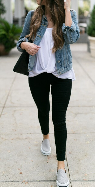 What's the standard uniform of the preppy varsity girl? Here you have it: black leggings, a white T-shirt, and a blue denim jacket. Keep it casually simple by adding a pair of gray slip-on loafers and a carry-all black tote bag.