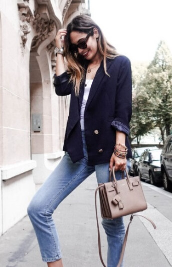 Get in on the trend by wearing a double-breasted navy blue blazer over cropped blue jeans and a simple white vest.