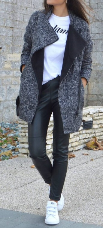 Preppy is by no means boring. How about slick leather leggings for a modern edge? Complement the outfit with a logo T-shirt and an oversized grey woolen coat for cooler fall days.