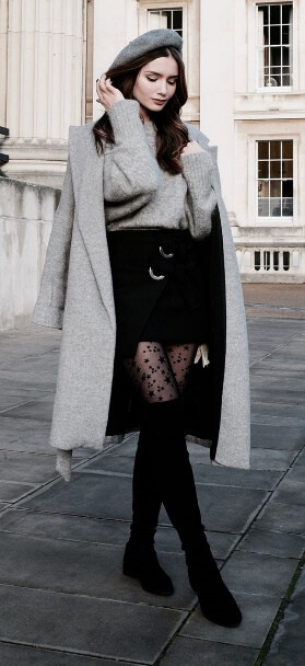 Timeless stylistic charm: wear a black miniskirt, patterned stockings and thigh-high boots with pale gray woolen extras.
