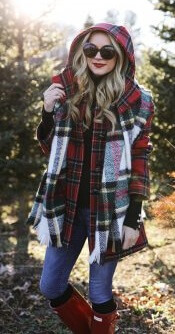 Don't be shy to make a statement by mixing your plaid patterns. A red tartan jacket is a perfect partner to blue jeans, red boots and a black and white plaid scarf.