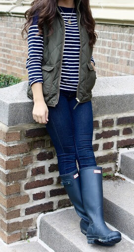 Need a little extra cover-up for rainy weather? Dust off those trusty boots and sleeveless puffer jacket to go along with a preppy striped top and jeans.