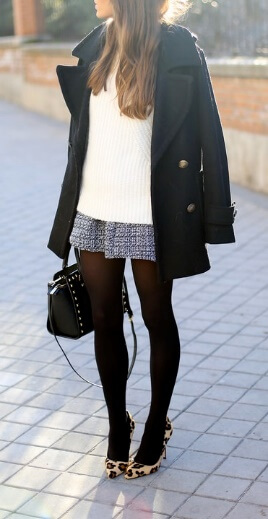 Just because the weather is cooling down doesn't mean you can't still show some leg. Try this preppy ensemble of a tweed miniskirt, black stockings and leopard-print heels.