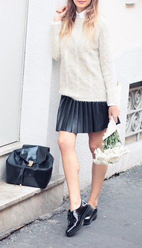 Style up a pair of shiny patent leather brogues with a cute pleated mini skirt and a cream-colored woolen sweater.