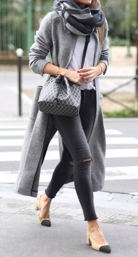 Faded black skinny jeans and a long gray cardigan turn this streetwear ensemble into an effortlessly stylish feat.