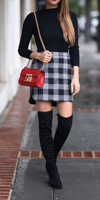 Get the sleek look by going for black on top and bottom with a splash of plaid print in the skirt.
