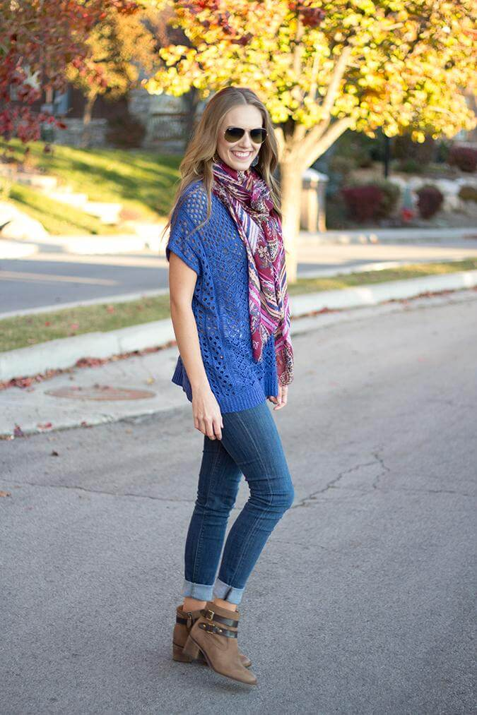 You can't go wrong with a blue jumper on blue jeans and brown booties. Add a colorful scarf to break the monotony.