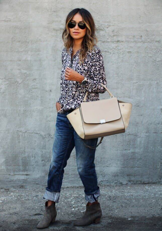 Boyfriend jeans look super chic with suede grey booties.