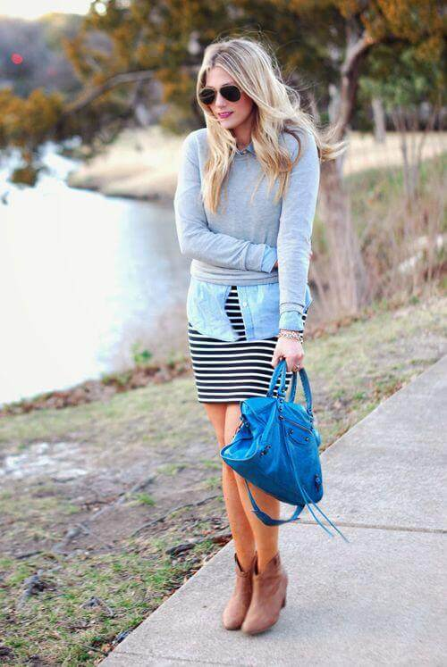Layers are to fall what pen is to paper. Wear a denim shirt with a striped skirt and throw on a grey sweater and brown booties for a flawless fall look.