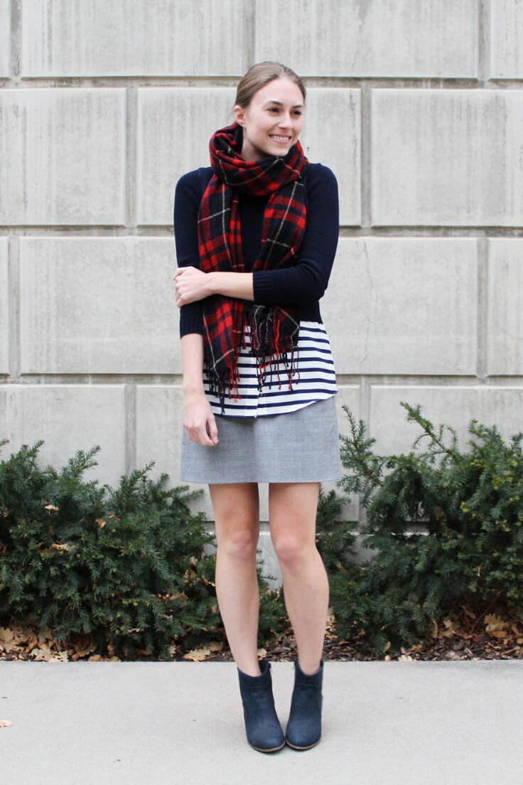 A short skirt is just as adorable during fall as it is during summer. Pair your grey mini with a striped top, black cropped sweater, and black booties. Add a little colour with a checkered scarf.