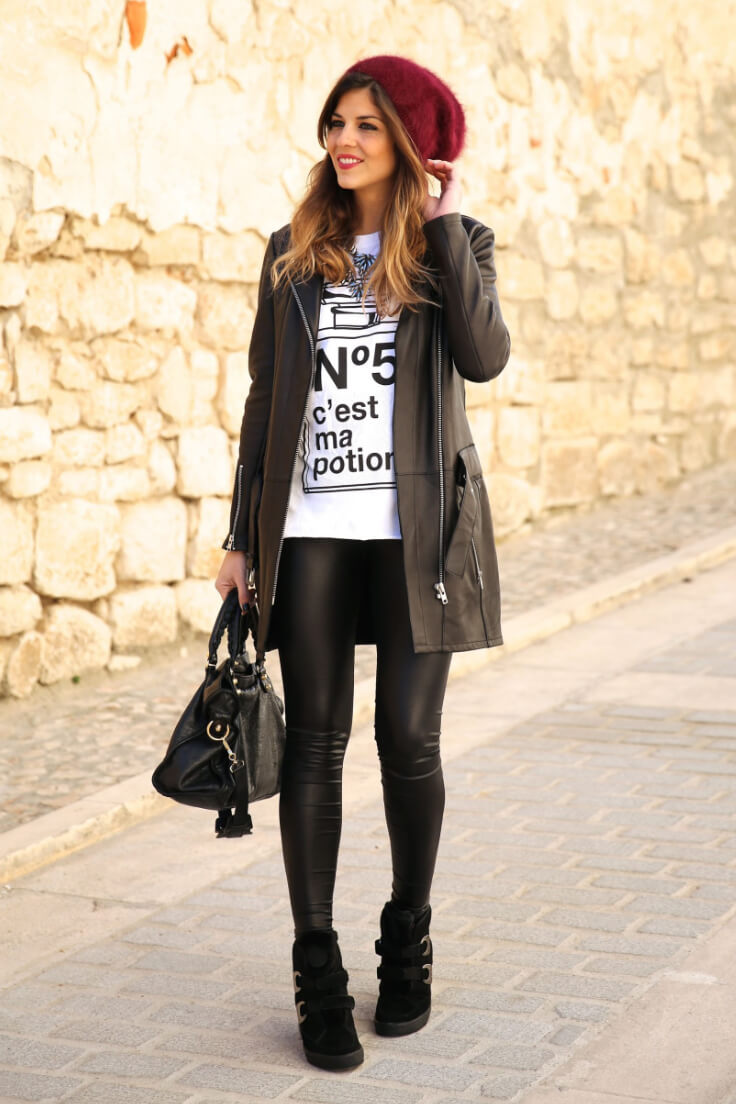 Graphic tees are everywhere right now. Layer yours with black leggings, a black jacket, and a cute beanie.