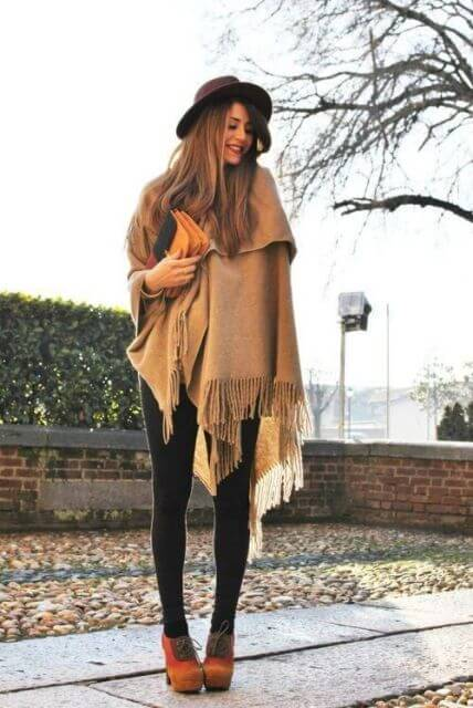 Keep it simple and sophisticated in plain black leggings, an oversized blanket scarf, and chunky booties. Add a hat for that extra chic factor.