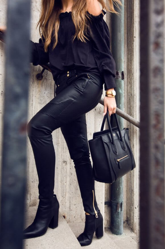 If you really want to push yourself, why not try some fierce leather leggings and chained booties? What a showstopper!