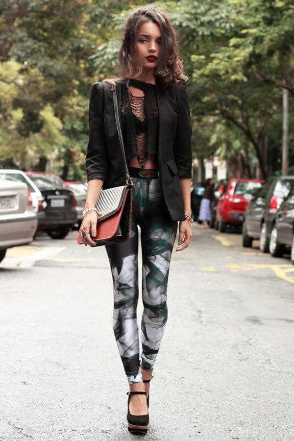 A ripped crop top with printed leggings is a daring look. Add a blazer to pull the look together.