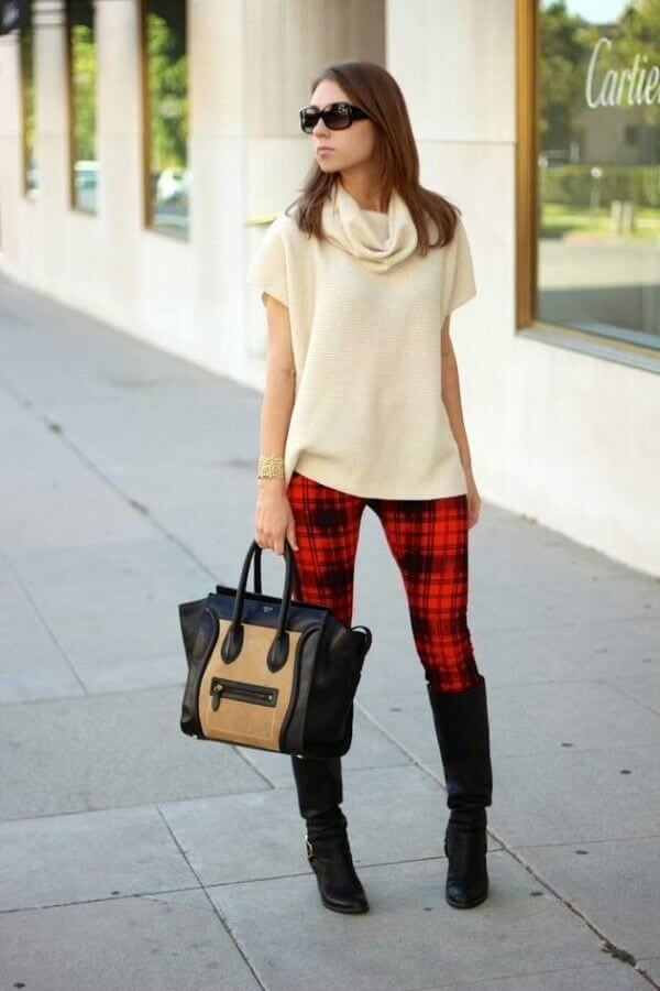 Pair checkered leggings with a plain beige sweater top to look fall ready!
