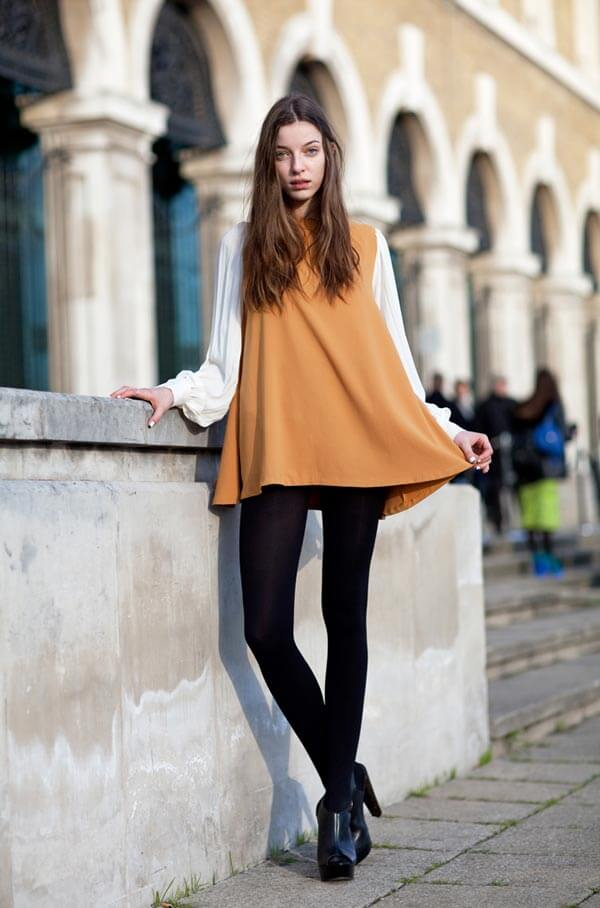 Mustard and black work so well together! Pair your flowy mustard top with black leggings and black ankle boots.