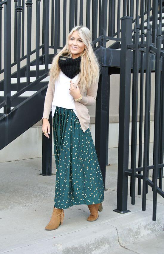 Try a printed skirt with a basic white tee, beige cardigan, and fringed booties for a fun fall look.