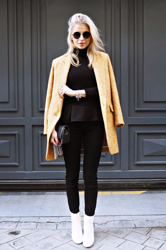 If an all-black look is too boring for you, bring it to life with a beautiful statement yellow jacket. Add white booties for an interesting touch.