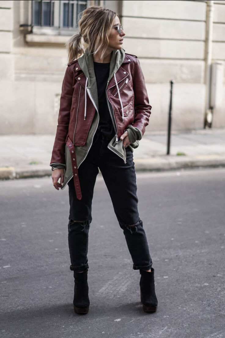 Channel your inner biker girl by trying a black on black look with a military green sweatshirt and an oxblood biker jacket. So fierce!