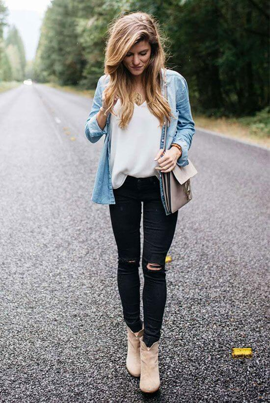 Lazy but want to look like you've made an effort? Try this simple but chic look with a white top, black distressed jeans, tan booties, and a trusty denim jacket.
