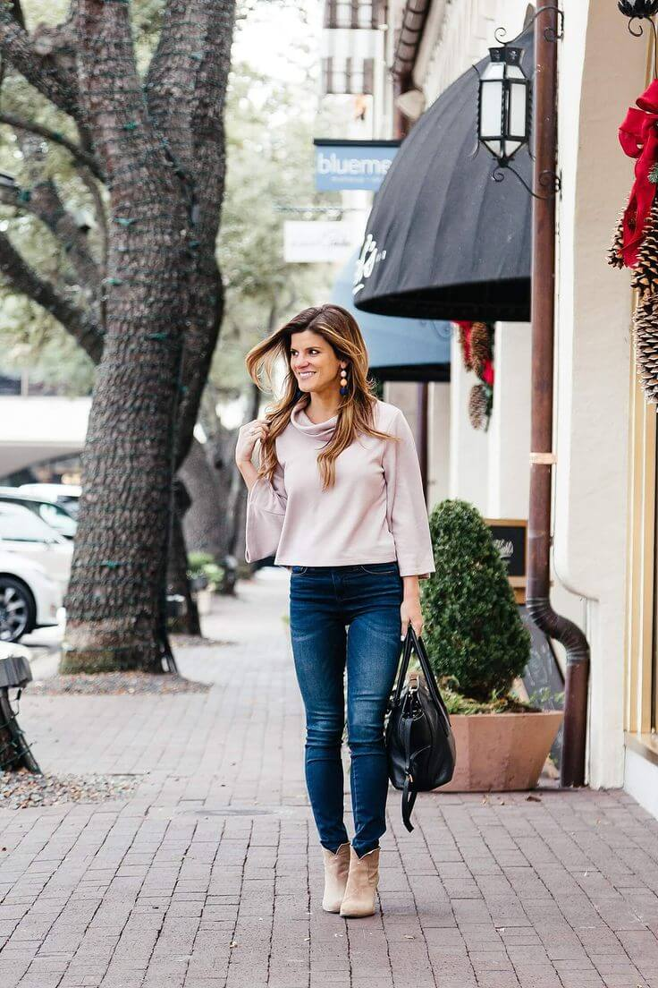 For a sweet, girly look pair a cowl neck top in this season's hottest colour- millennium pink with your trusty blue jeans and some sassy booties.