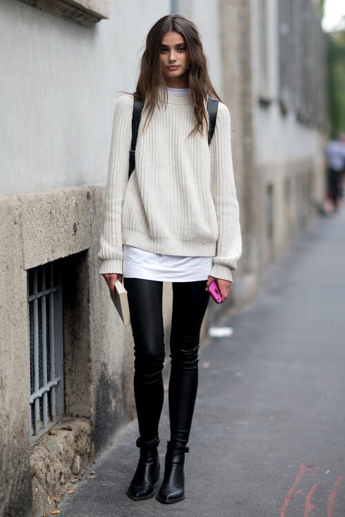 Give your mini skirt a fall makeover by pairing it with thick black leggings and an oversized sweater.