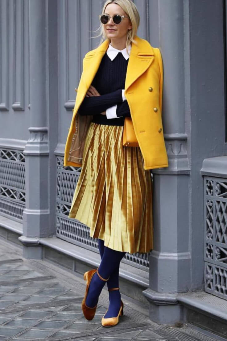 Take a cue from this sartorialist on how to stand out in a crowd. Pair a golden skirt with blue leggings, golden shoes, black top, and a bright yellow jacket. This is certainly not for the faint-hearted!