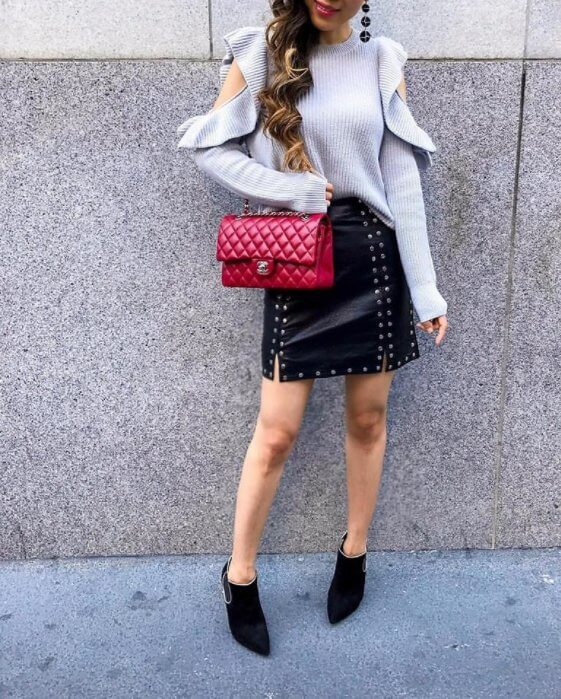 Impressive black skirt matched with black boots