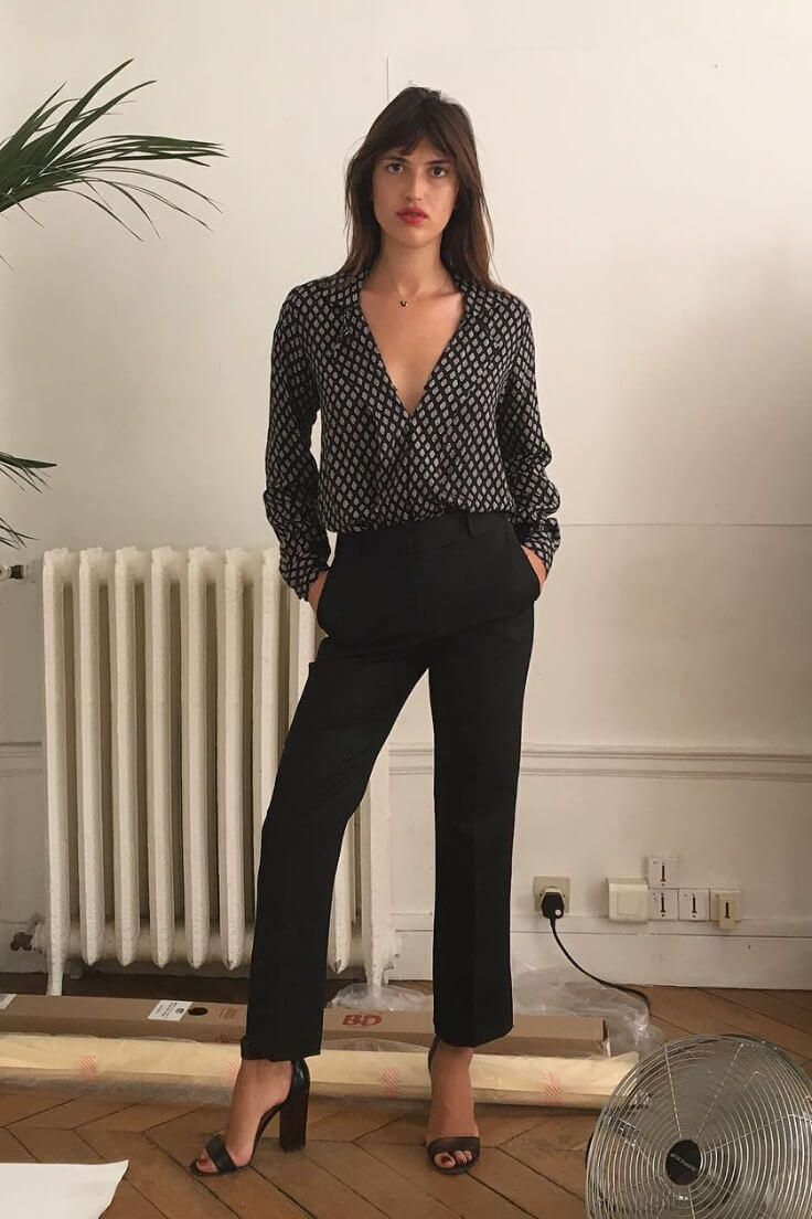 Tailored black pants are the most versatile item for a chic French work wardrobe