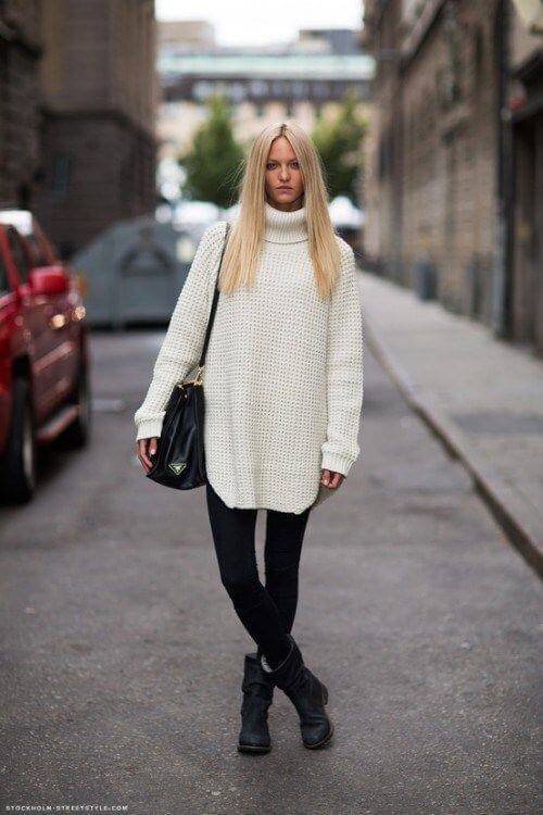 Time to get back to the basics with an oversized turtleneck sweater, black leggings, and black boots.