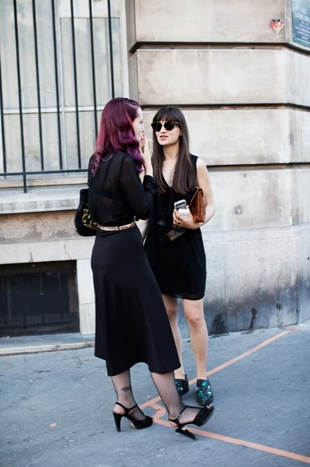 Black French style look: this trendy duo is decked out in a stylish all black in the artsy Marais district