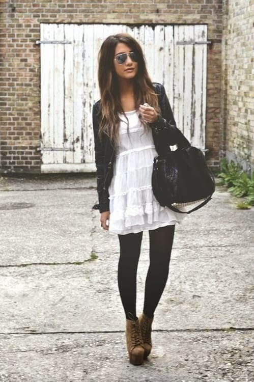 Give your white summer dress a new lease of life by wearing it with leggings, boots, and a leather jacket.