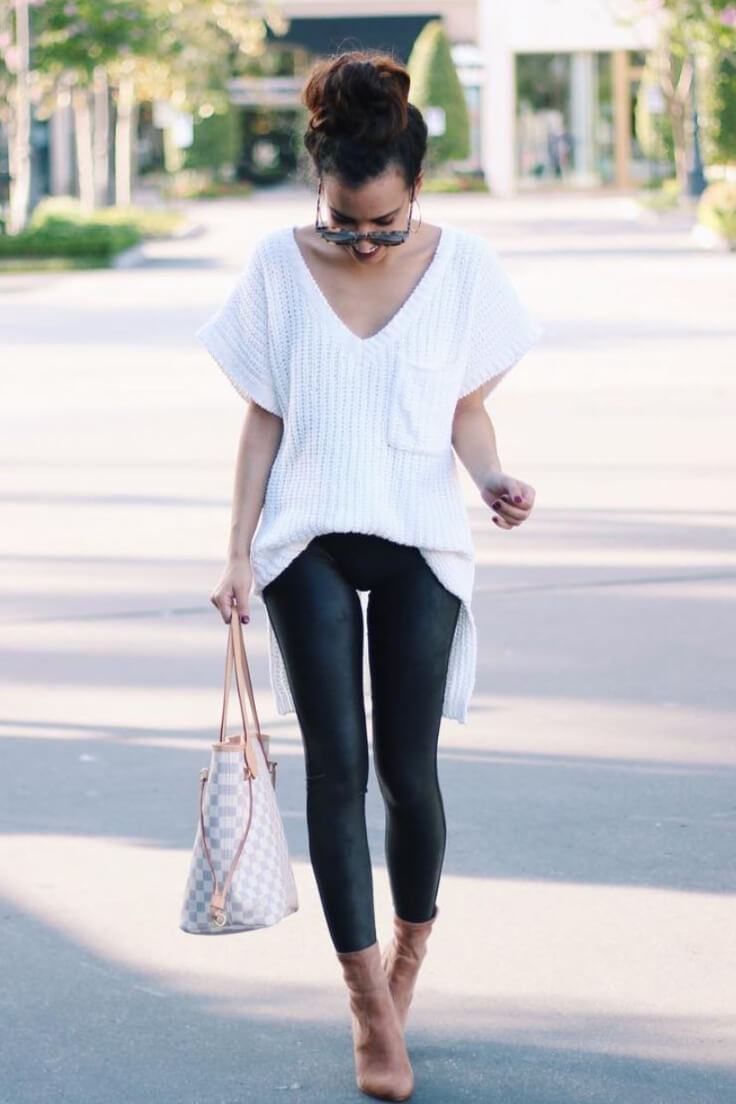Add a twist to the classic black and white combo with a pair of black faux leather leggings.