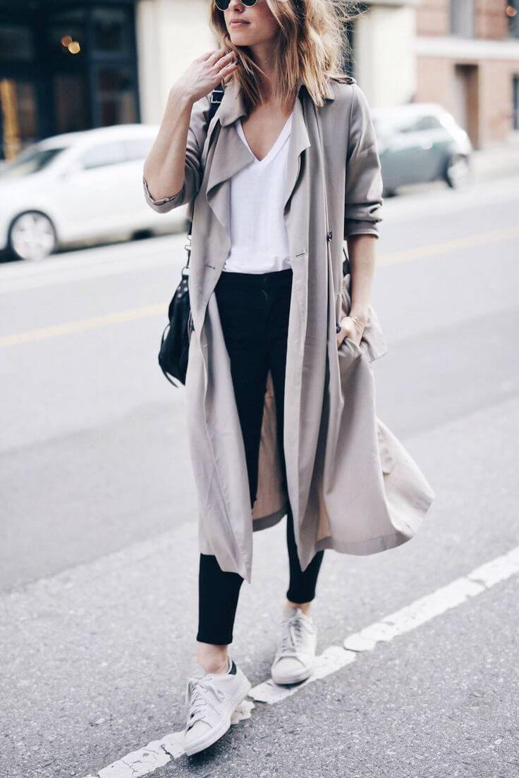 Let's face it, ladies - you simply cannot go wrong with a white tee, black leggings, and white sneakers. Add a beautiful beige duster for a feminine touch.