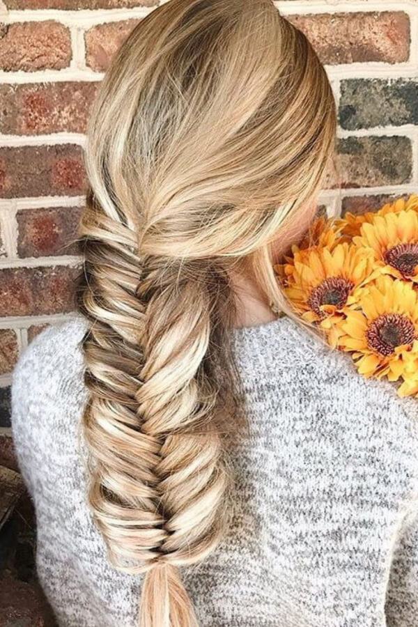 A fishtail braid is a perfect style to achieve that intricate look without having to try too hard