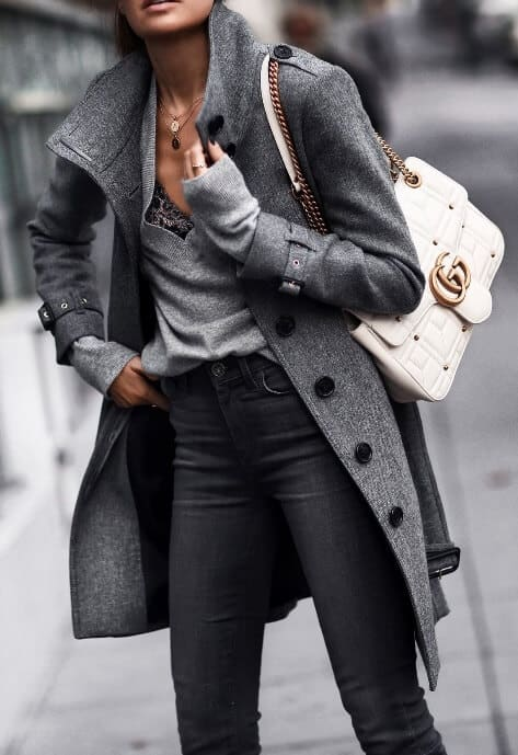 Lighter layers kept to a minimalist charcoal gray. An exposed neck during wintry weather can be oh so sexy.