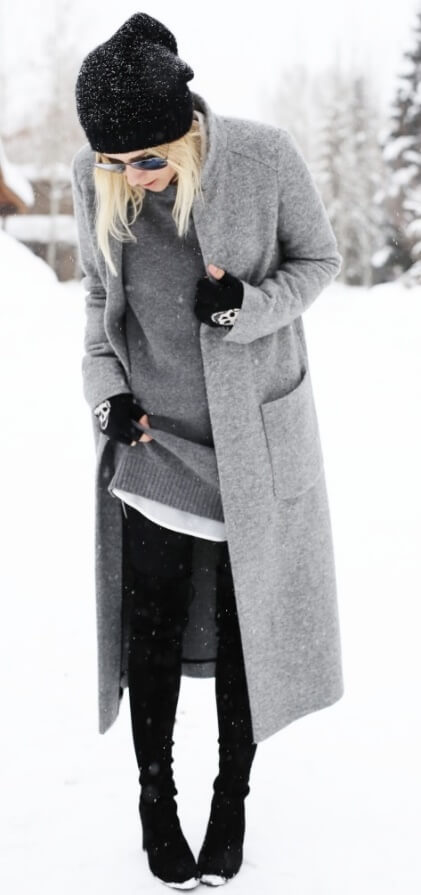 A mix of a cardigan and a coat - the ideal choice if you live in an area prone to snow, sleet and unpredictable winter conditions. This layered look comprises all sorts of wool in black, white and gray. You would hardly even notice the number of layers though due to the neutral, minimalist colors.
