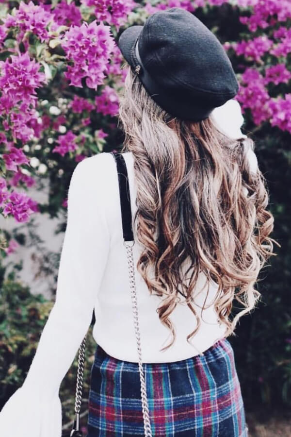 Beautiful wavy hair and a hat