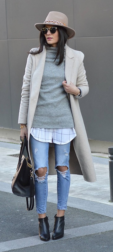 An ultimate cool-girl layered ensemble that centers around a woolen sweater. Starting with ripped jeans, add on a long button-down shirt plus a sweater. Accessories are entirely optional, but what a difference they make!