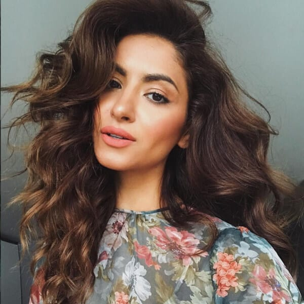 If you are not blessed with voluminous hair, you can always resort to a little light teasing to achieve the desired look